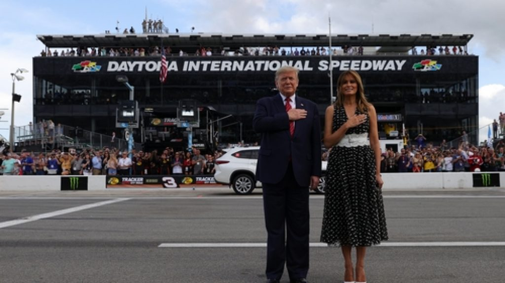Mr & Mrs Trump stand to attention at Daytona